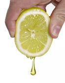 Hand squeezing a lemon,lemon drop — Stock Photo