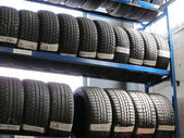 The tire store in the garage — Stock Photo