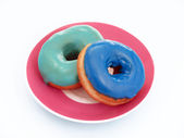 Colored dough nuts — Stock Photo