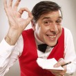 Young and funny waiter portrait on white background. Waiter portrait taking order. — Stock Photo