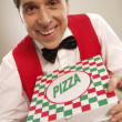 Pizza delivery man holding pizza box - Stock Photo