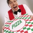 Pizza delivery man holding pizza box — Stock Photo