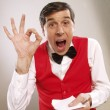 Young and funny waiter portrait on white background. — Stock Photo