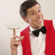 Expressive waiter holding an empty plate. — Stock Photo #13966162