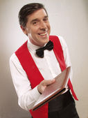 Young and funny waiter portrait on white background — Stock fotografie