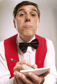 Young and funny waiter portrait on white background. Waiter portrait taking order — Stock Photo