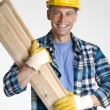 Royalty-Free Stock Photo: Worker holding wood boards
