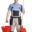Worker holding a red bucket and shovel on white background. — Stock Photo #14108120