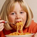 Little girl eating pasta,kid eating pasta, — Stock Photo