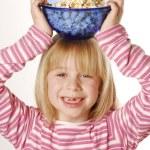 Little girl eating popcorn — Stock Photo #14108920