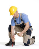 Worker hammering.chisel on white background. — Stock Photo
