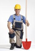 Construction worker portrait holding a shovel — Stockfoto