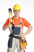 Construction worker holding a big pliers on white background. — Stock Photo