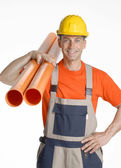 Plumber holding two plastic orange tubes — Stock Photo