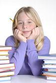 School girl portrait behind books. — Stock Photo
