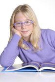 School little girl reading and studding. — Stock Photo
