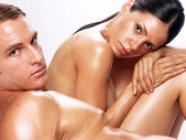Portrait of a young undressed couple on white background — Stock Photo