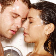 Young couple enjoying together in a jacuzzi - Stock Photo