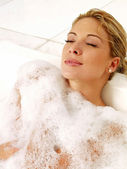 Young woman in jacuzzi — Stock Photo