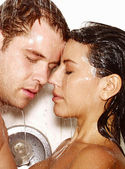 Young couple enjoying together in a jacuzzi — Stock Photo