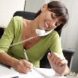 Optimist hispanic businesswoman working at office - Stock Photo