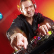 Disc jockey working at discotheque. — Stock Photo #14397267