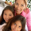 Mother and daughters portrait. — Stock Photo