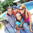 Happy family taking pictures. — Stock Photo #14397763