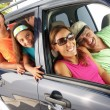 Hispanic family in a car. Family tour in a car. - 图库照片