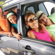 Foto Stock: Hispanic family in car. Family tour in car.