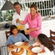 Stock Photo: Hispanic family having breakfast in a kitchen.