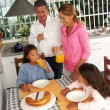 Hispanic family having breakfast in a kitchen. — Stock Photo