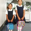 Two little sisters going to school. — Stock Photo #14397807