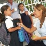 Hispanic little girls going to school. Hispanic family at kitchen. — Stock Photo #14397819