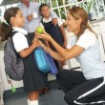Hispanic little girls going to school. Hispanic family at kitchen. — Stock Photo #14397821