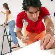 Young hispanic couple working and moving to a new home. — Stockfoto