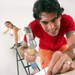 Young hispanic couple working and moving to a new home. - Stock Photo