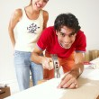 Hispanic couple working on a new home. — Lizenzfreies Foto