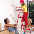 Young hispanic couple working on a new home. - Stock Photo
