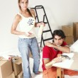 Young hispanic couple working on a new home. — Foto de Stock