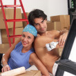 Hispanic young couple moving to a new home. — ストック写真
