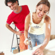 Hispanic couple working on a new home. - Foto de Stock