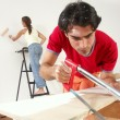 Hispanic couple working at new home. — Stock Photo