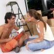 Young hispanic couple working and moving to a new home. — Stock Photo