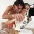 Young hispanic couple working and moving to a new home. - Stockfoto