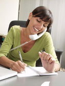 Optimist hispanic businesswoman working at office — Stock Photo