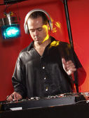 Disc jockey working at discotheque. — Stock Photo