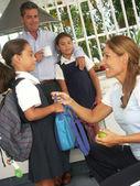 Hispanic little girls going to school. Hispanic family at kitchen. — Stock Photo
