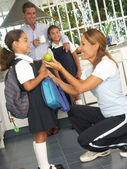 Hispanic little girls going to school. Hispanic family at kitchen. — Stock Photo