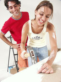 Hispanic couple working on a new home. — Stock Photo